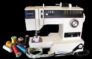 sewing machine, thread, tape measure, scissors